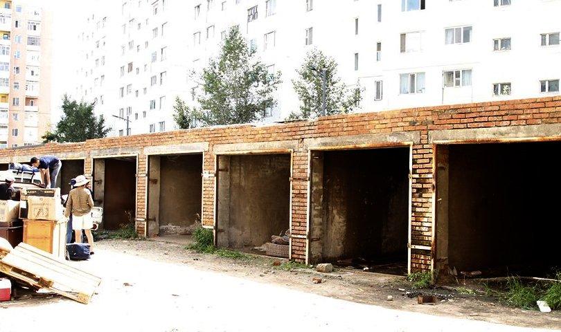 15개의 벽돌식 차고와 3개 철제 차고를 강제로 철거하고 토지를 비워.jpg